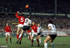 England defender Jack Charlton heads away from Uwe Seeler of West Germany watched by Bobby Moore Ray Wilson Helmut Haller and Lothar Emmerich during. 1958 World Cup, 1966 World Cup Final, Germany National Football Team, Jack Charlton, Germany Team, Bobby Moore, England Football, Europa League, Finals