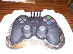 "I asked my husband how he wanted me to decorate his birthday cake and said, ""Make it look like a Playstation controller.""  I had never carved a cake before this and he knew it.  He's wonderful at challenging me!  Look how it turned out!"