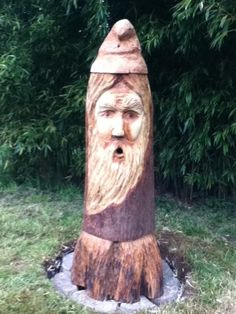 Bee Beard ready for occupiers. A carved tree hollowed out and used as a hive. Bees come out the mouth.