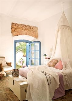 just adding the little stone arch with the blue door is the only decor needed...notice - no wall treatment or artwork....