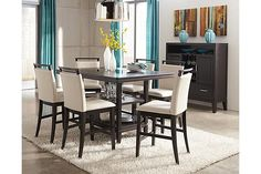"""The Trishelle Counter Height Dining Room Table from Ashley Furniture HomeStore (AFHS.com). With a sleek straight-line contemporary design bathed in a dark espresso color finish complementing the Okoume and Ash veneers, the """"Trishelle"""" dining collection features a sleek saber leg table with inset black glass in the table top along with upholstered chairs that create a stunning furniture collection."""