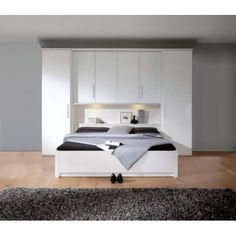 des placards de rangement autour du lit photos et design. Black Bedroom Furniture Sets. Home Design Ideas