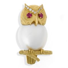 """18k Yellow Gold Pearl Owl Pin on Branch. This Owl is beautifully textured with 18k Gold and handmade in England. Body is a cultured Pearl, with cabochon Ruby eyes and sparkling Diamonds (.07 tcw) along the brows. Measures ¾"""" w x 1 ⅛"""" h. •$4,000"""