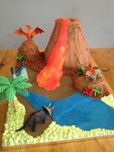 A few strategically placed plastic dinosaurs finish the effect. Just add candles, a sparkler in the volcano hole, and a very excited group of children!