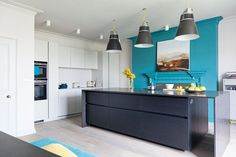 industrial style kitchen in a coastal townhouse