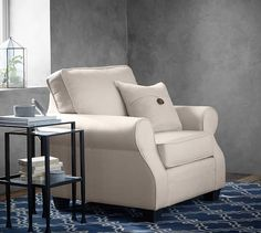 The Pottery Barn SoMa Fremont Armchair fits value and casual style into a compact footprint that's perfectly designed for relaxing in every home.