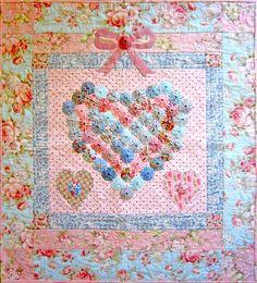 Yoyo heart quilt