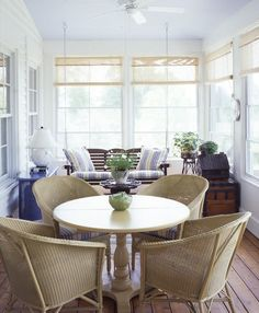 Cute seating arrangments for enclosed porch, very inspirational !