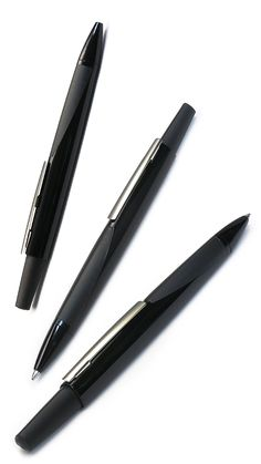 PELIKAN – th.INK ballpoint. Ergonomic triangular barrel with two-toned gloss black and matte rubber grip zones. Very lightweight for the price. Also in fountain pen and capped rollerball. Launched 2012-13.