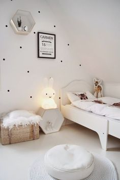 Dotty walls and white kids room. Little kids room.