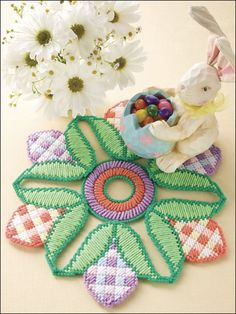 Easter Egg Doily    Sunny pastels provide a cheerful tabletop accent throughout the Easter season. This e-pattern was originally published in Happy Holidays in Plastic Canvas.