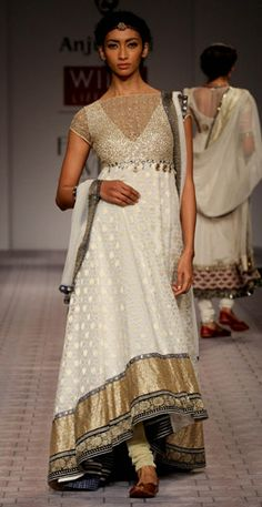 Price in USD: $ 1,648.00     Ivory cut work Yoke, uneven Gold bottom And Blue Kurta | Dupatta| Churidar-anju modi