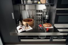 Kitchen Design Idea - Pull-Out Counters (10 Pictures) // The stainless steel surface of this work space can be pulled out to nearly double the amount of prep space you have.
