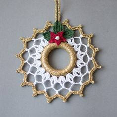 Lovely crochet Christmas wreath. Christmas decoration. Gold white decor. This wreath is 5.7  (14 cm.) in diameter.  Hand crocheted with high-quality cotton thread in a smoke-free and pet-free environment whit great attention to details.  It is starched and arrives very well packed in a sturdy box.  You can find other Christmas ornaments and presents for your loved ones here:  https://www.etsy.com/shop/SevisMagicalStitches?ref=l2-shopheader-name  and some knitted items...