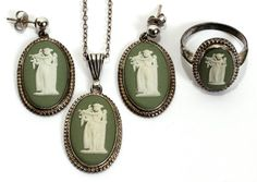 "WEDGWOOD GREEN JASPERWARE CAMEO PENDANT, EARRINGS & RING, 1932:The pendant has a British sterling hallmark with date and the 16"" chain is marked sterling, the ring is marked JW with hallmarks and the earrings, with posts, are marked SILVER FAW. Accompanied by a Wedgwood box."
