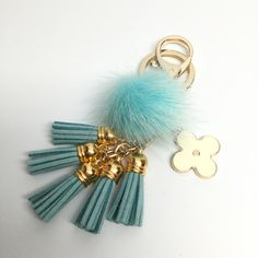 26.00$  Buy here - http://vihdo.justgood.pw/vig/item.php?t=hkt0b134372 - Cute Genuine Mink Fur Pom Pom Keychain with suede tassels and flower charm in Aq 26.00$