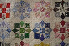 Hand Pieced by Janet Gray. Freehand machine Quilted by Jessica's Quilting Studio