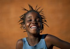 -Angola Kids Smiling | Eric Lafforgue Photography