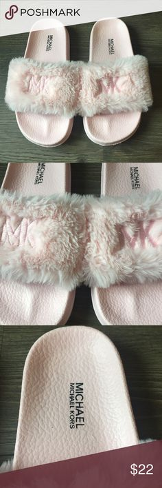 🆕 🎀 NWOT Girls Michael Kors Furry Slides Brand new without tags girls Michael Kors baby pink furry slides. MK is embroidered on the front. Super chic for a little fashionista.  I bundle so be sure to check out my other cute options! Always accepting reasonable offers! MICHAEL Michael Kors Shoes Sandals & Flip Flops