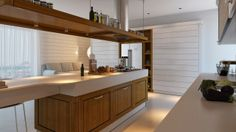 kücheninsel mit kochbereich-essbereich holz-unterschränke