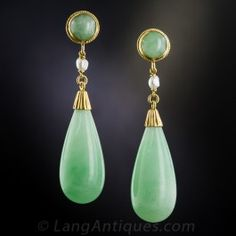 Big, bright, light apple green jade pendeloque drops swing and sway from matching round tops, punctuated by a single freshwater pearl, in these 1 and 3/4 inch long and lovely, fun and festive, mid-century vintage earrings. (The bottom drops alone measure over an inch long.) Accompanied by an SGL gemological report stating natural Burmese jadeite.