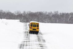 With icy conditions and a two hour snow delay this school bus takes caution w/ strobe light activated on Mill Road in Mattituck during another storm on Feb. 5, 2014. (Credit: Randee Daddona)