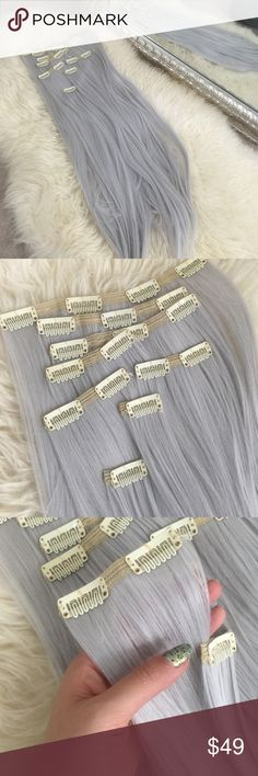 Luxury Synthetic Clip Extensions 8 pc Double Weft Gorgeous brand new silver gray synthetic clip in extensions. Same quality as Bellami synthetic ponytails. Extra replacement clips, needle and thread included. Your item will not be opened. The pictured product is my own set. They can be dyed and heat styled but please note methods are different for synthetic fibers. Last pic is my shorter set of silver extensions. These are longer at 24 inches 210 grams Boutique Accessories Hair Accessories