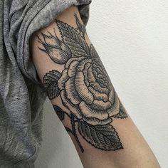 Upper arm rose tattoo