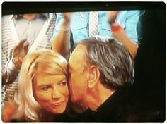 This is Neil Diamond giving his wife a a kiss on the ear.