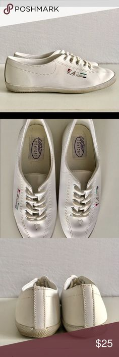 "Vintage LA Gear Sneakers Vintage LA Gear Sneakers come in white with five hole lace up. Size: 6 Heel to Toe: 9"" Width: 3"". 100% Leather and 100% Man Made Balance Sole. In excellent used condition. LA Gear Shoes Slippers"