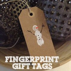 Sewing Barefoot: Fingerprint Snowmen Gift Tags. Kids can make these to gift their grandparents along with some artwork.