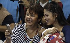 Nicole Johnson, right, the fiancee of United States' Michael Phelps, and his mother Debbie...