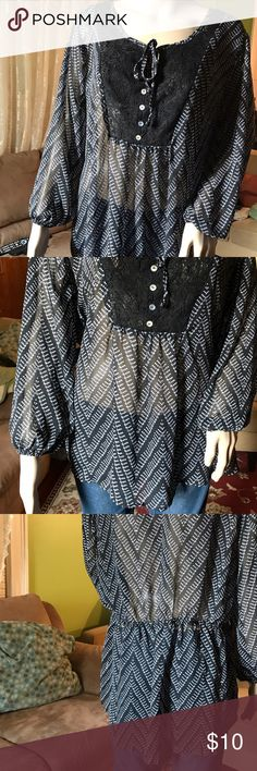 Black and white sheer tunic blouse sz XXL/2XG Black and white patterned sheer tunic blouse with a lace front detailing with buttons.Size XXL/2XG No Boundaries Tops Tunics