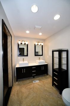 Master bathroom with a double vanity with two vessel sinks.