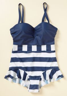 With a flattering gathered bust, convertible straps, and sweet ruffles at the legs, this white-and-navy High Dive by ModCloth suit keeps you feeling cool on the classy scene. http://shareasale.com/r.cfm?b=758999&u=1422417&m=43745&urllink=https%3A%2F%2Fwww%2Emodcloth%2Ecom%2Fshop%2Fvintage%2Dswimsuits%2Fhaute%2Din%2Dthe%2Dhamptons%2Done%2Dpiece%2Dswimsuit%2F10092133%2Ehtml%3Fdwvar%5F10092133%5Fcolor%3DBLU%26cgid%3Dvintage%5Fswimsuits%5F2303&afftrack=