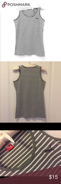 ⚽️Puma Grey & White stripe Tank Top⚽️ I love how soft this tank top is and wish I could figure out how to show that! It's so super soft and comfortable.  Could be worn to work out but really is meant for every day wear.  NWOT but too small for me. Can be Bundled with the Ralph Lauren Tank Top I have listed to get both for $20. Puma Tops Tank Tops