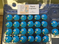 Pigeon Cupcakes, based on Mo Willem's Pigeon book series, for my daughter's book themed party!  Plain cupcakes, iced in blue, with candied eyeballs.  I used peach gummies, cutting them into triangle shapes, for the beaks!