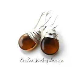 Mocha brown transparent pear Czech Picasso glass wire wrapped Argentium silver earrings.