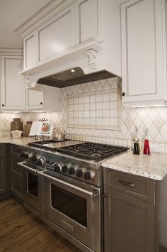 This is the stove, backsplash, hood, colors, look - needs marble countertops. Carolina Design Associates, LLC's Design, Pictures, Remodel, Decor and Ideas - page 2