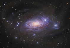 The Sunflower Galaxy (also known as Messier 63 or NGC 5055) is a spiral galaxy of nearly 100,000 light-years across – so, about the size of our own Milky Way, located about 37 light-years away in the small northern constellation of Canes Venatici (the Hunting Dogs), while it is receding from us at some 504 kilometers per second. It is part of the M51 Group, a group of galaxies that also includes the Whirlpool Galaxy (Messier 51).
