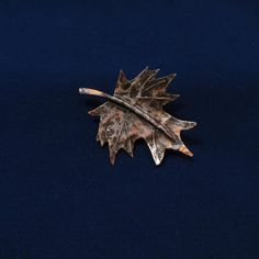 Hello. I invite you to look at the unique copper brooch. Brooch presents a maple leaf. Picture number 7 shows the back of the brooch. I made the brooch entirely by hand. It is not a combination of ready-made elements (except for the clasp). I created only one piece. Copper elements were