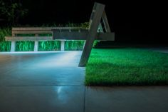 This custom-made hardwood seating area was formed out of sapele wood. After dark, the under-lighting of the bespoke benches creates a gentle glow to the garden. After Dark, Outdoor Furniture, Outdoor Decor, Benches, Bespoke, Hardwood, Glow, Gardens, Landscape