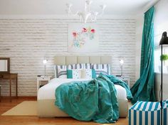 White brick wall.  Turquoise curtains.  <3 it.
