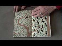 Mattias Adolfsson flips through a Moleskine sketchbook. #BeInspired
