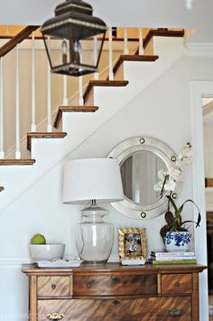 front hall | entryway styling | tabletop vignette | glass lamp | porthole mirror | lantern
