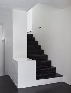 Black staircase inside Haus Hemmi  by Michael Hemmi.