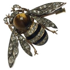 1870s Enamel Quartz Tiger's Eye Diamond Silver Gold Bee Brooch | From a unique collection of vintage brooches at https://www.1stdibs.com/jewelry/brooches/brooches/