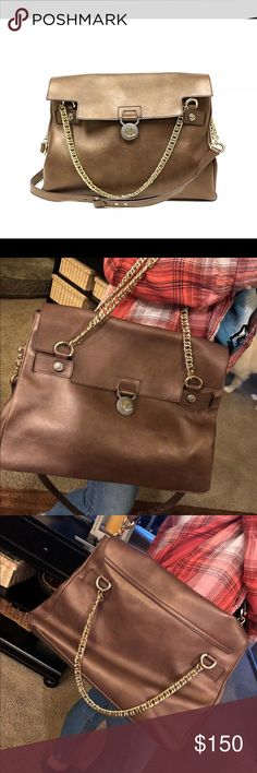 Brown Leather Versace Bag In almost perfect condition! Is missing the back of the decorative pendant on front of bag (as pictured) but can not be seen unless you look for it. Sells for $750 new. Versace Collection Bags Crossbody Bags