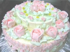 Let's get back to the basics. A real birthday cake. When the icing had flavor! A stunning butter cream icing birthday cake. Covered in pale pink icing roses