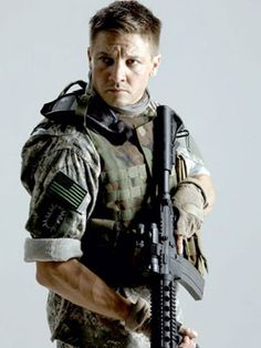 Renner in uniform. Yum. Interesting note--the flag patch is backwards. On that side of the uniform the stars should be to the front. As if the flag was streaming into battle.